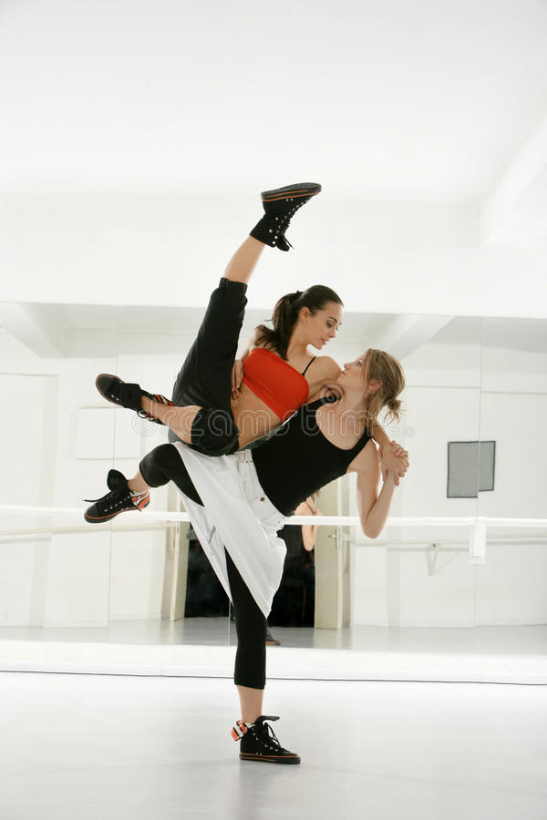 Two young and beautiful dancers show dance techniq royalty free stock photo