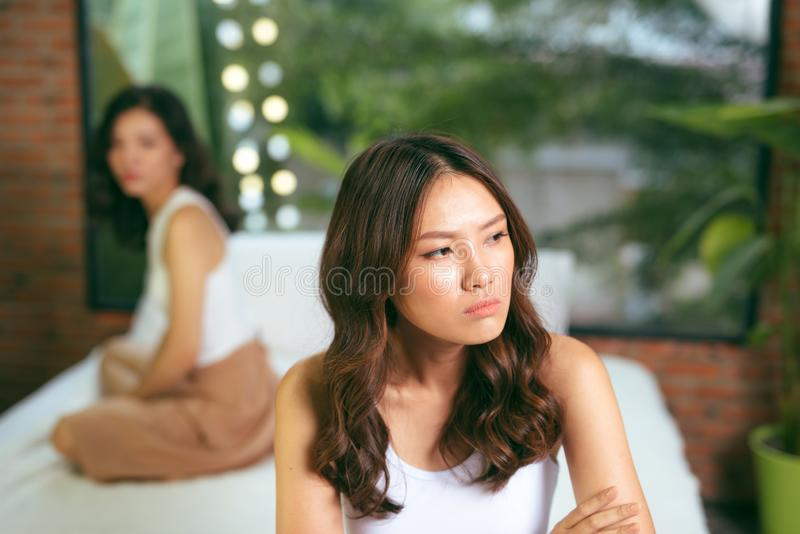 Two young beautiful women angry with each other at home.  royalty free stock photos