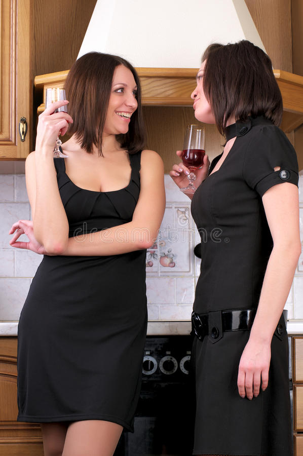 Two young beautiful women talking royalty free stock images