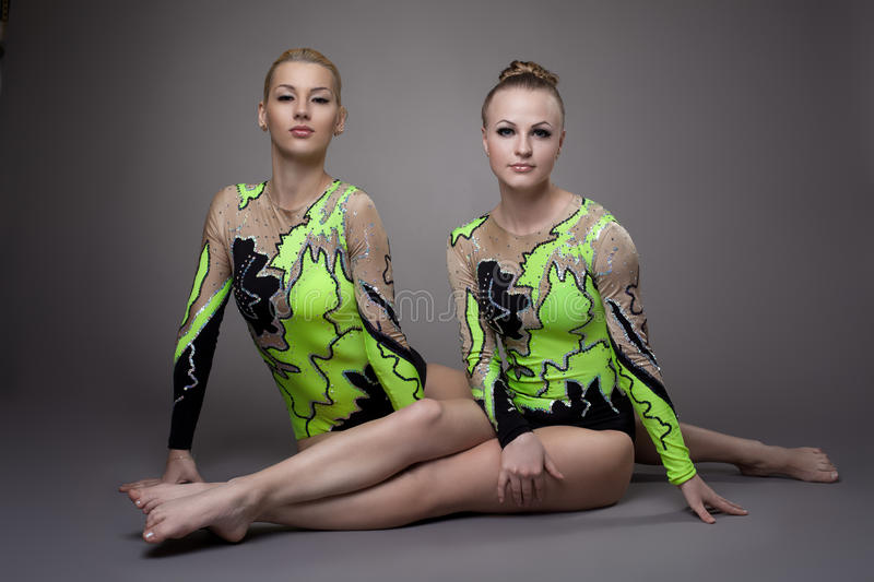Two Young beauty acrobats relax portrait royalty free stock photography
