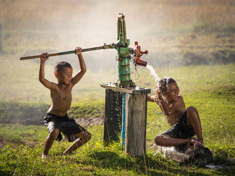 Two young boy rocking groundwater bathe in the hot days. Two young boy rocking groundwater bathe in the hot days, Countryside Thailand stock photos