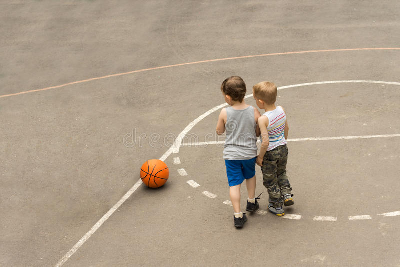 Two young boys on a basketball court royalty free stock photos