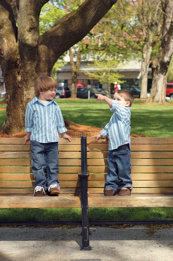 Two Young Brothers - Park Bench stock images