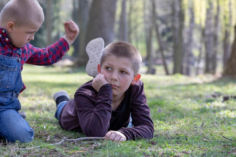 Two young brothers quarreling  in the Park stock images