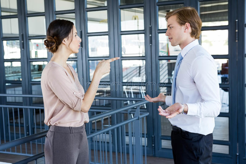 Two young business colleagues having an argument. In office stock photos
