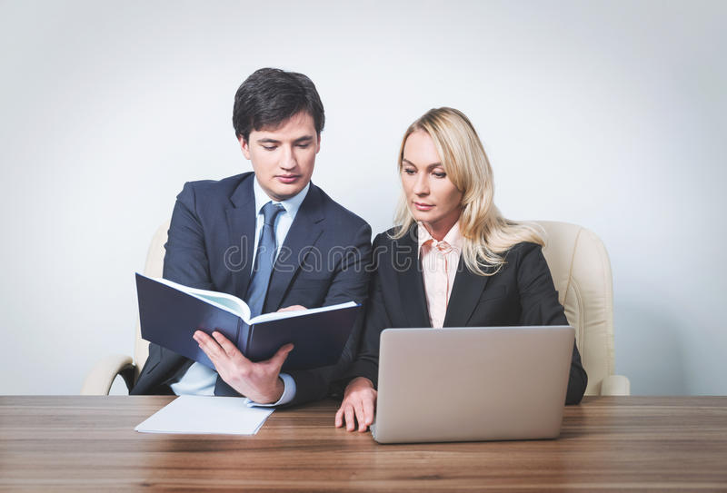Two young business partners at meeting stock images