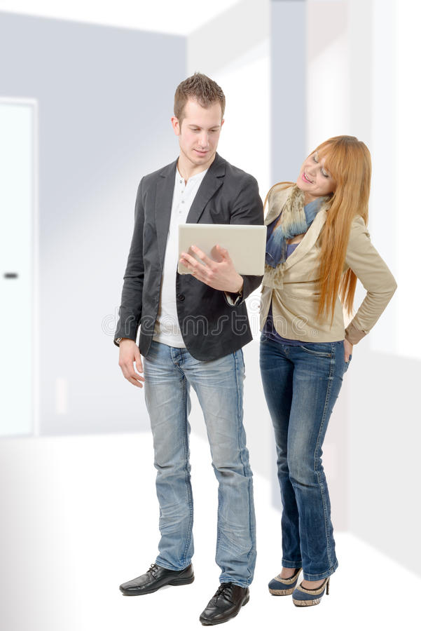 Two young business people working with a laptop royalty free stock images