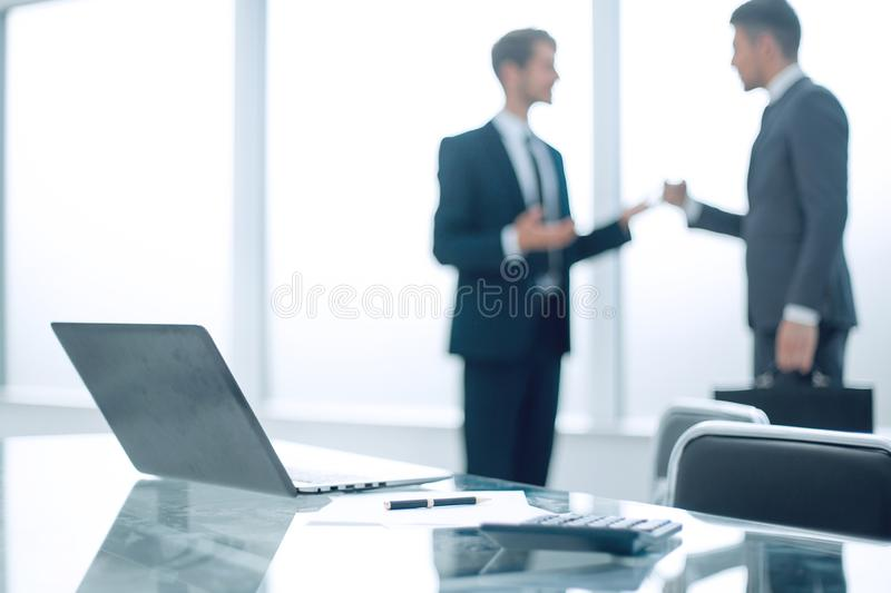 Two young businessmen are introduced to each other. Two young successful businessmen present themselves at a business meeting stock image
