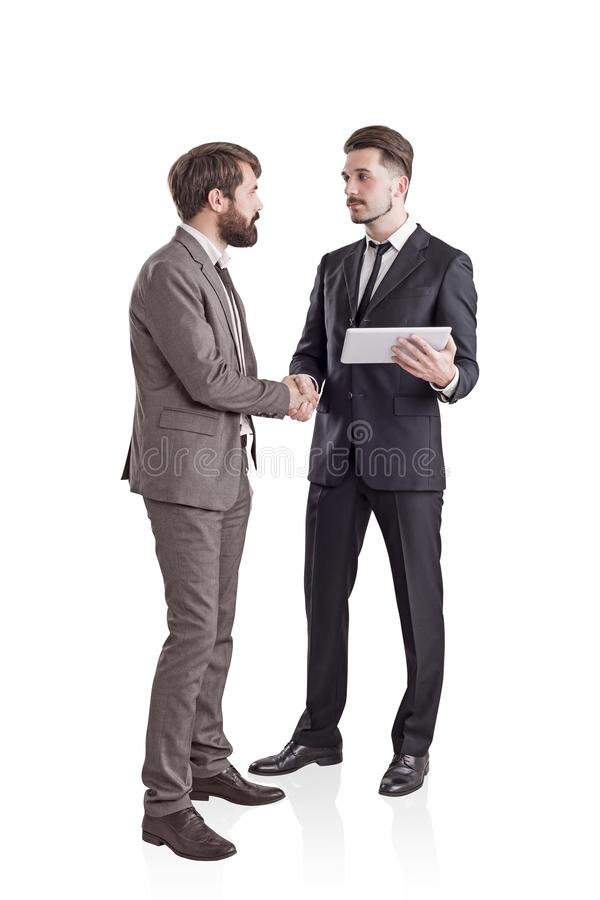 Two young businessmen shaking hands, isolated stock images
