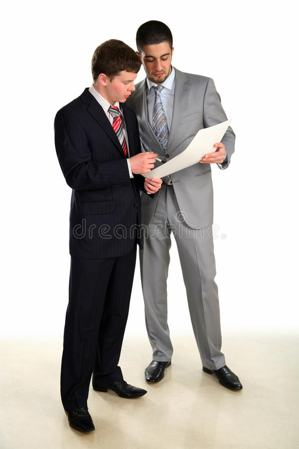 Two young businessmen working and confer