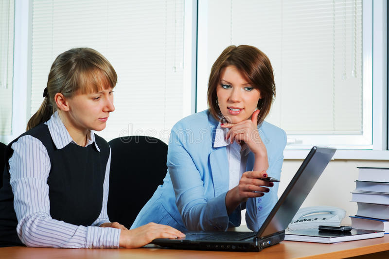 Two young businesswoman. royalty free stock image
