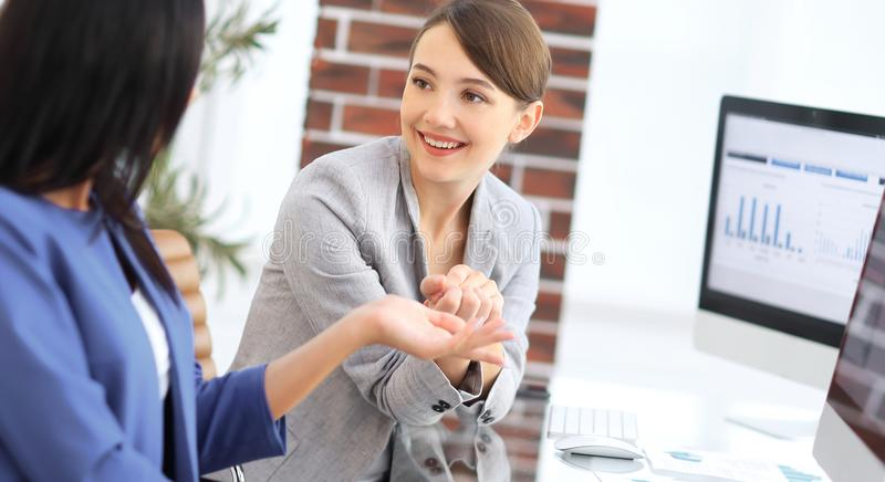 Beautiful girls working together in the office royalty free stock photography