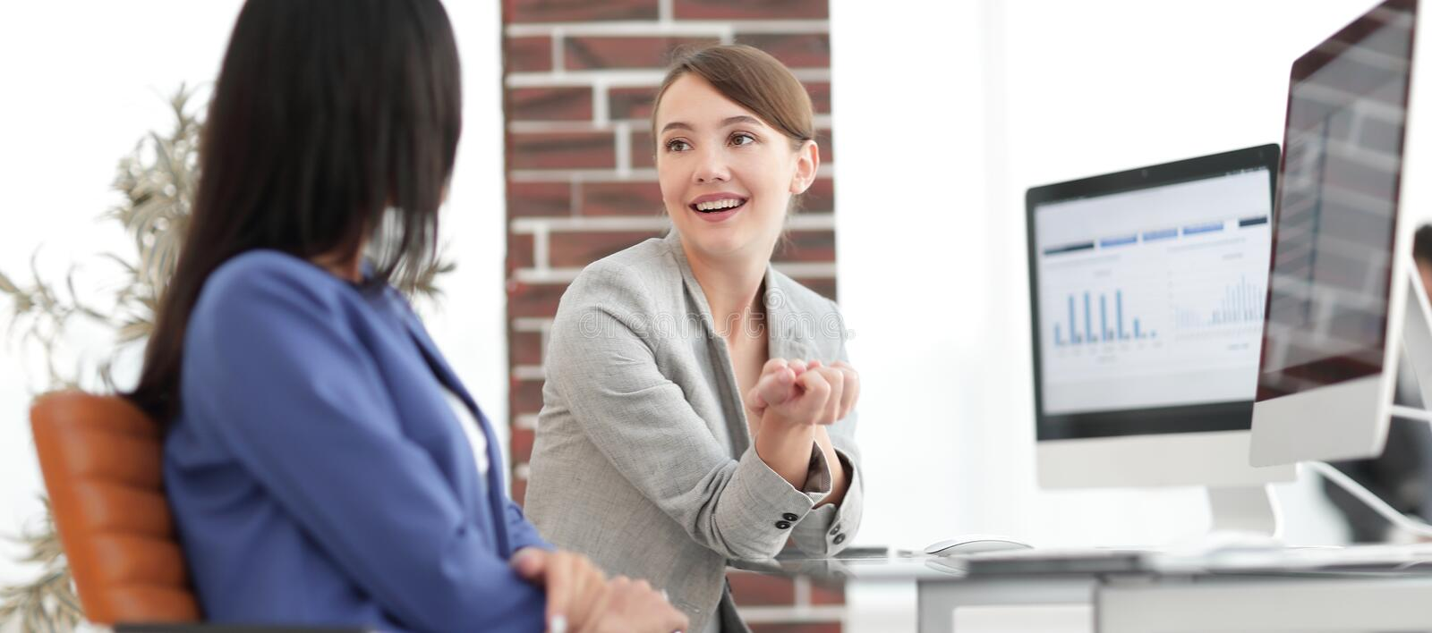 Beautiful girls working together in the office stock image