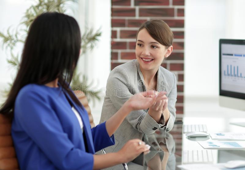 Beautiful girls working together in the office royalty free stock images