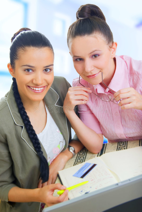 Download Two Young Businesswomen Working Stock Image - Image: 5564955