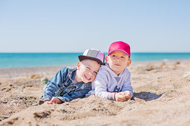 Two Young Children Playing in the Sand royalty free stock photo