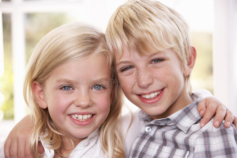 Two young children pose together stock images