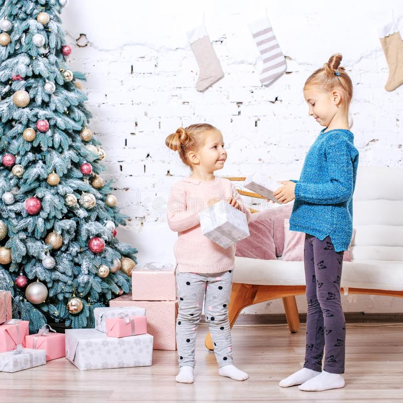 Two young children received gifts. Concept New Year, Merry Chris. Tmas, holiday, family, winter childhood stock image