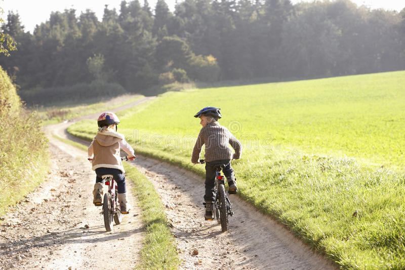 Download Two Young Children Ride Bicycles In Park Stock Photo - Image: 17489276
