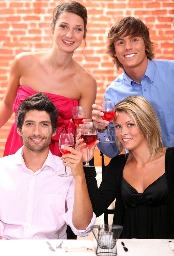 Two young couples drinking stock photos