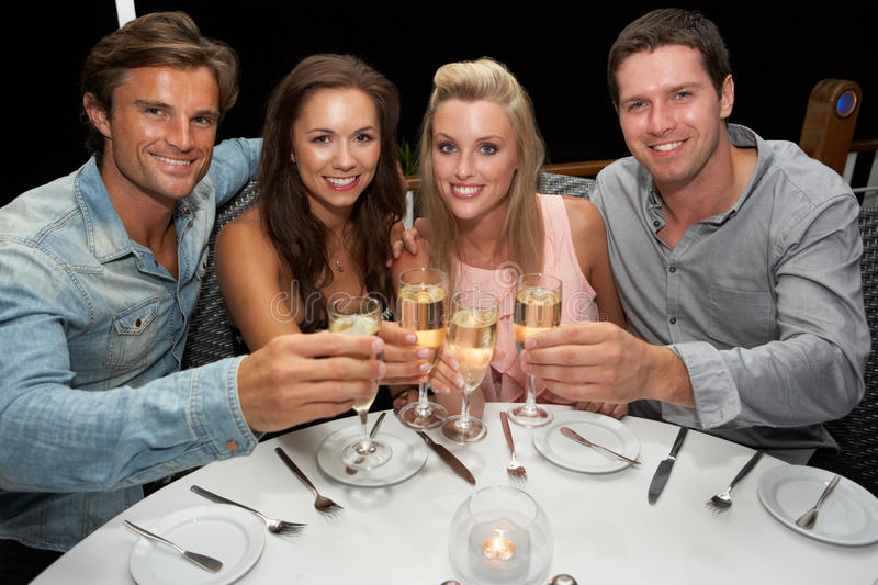 Two young couples in restaurant royalty free stock image