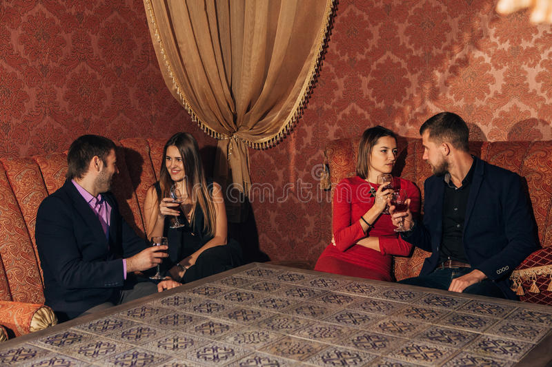 Two young couples in restaurant royalty free stock photos