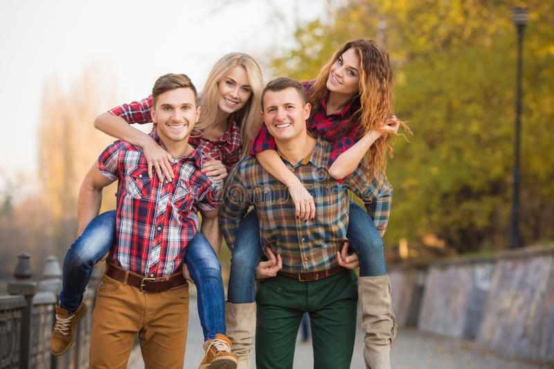 Two young couples spend time in the Park stock photos