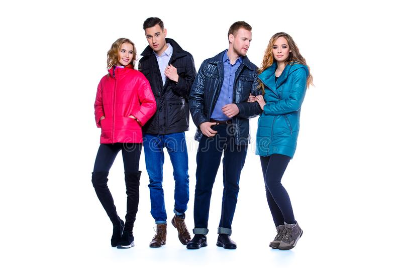 Two young couples. In winter clothes in a studio.Fashion shot royalty free stock images