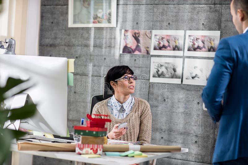 Two young designers discussion. At work stock photos
