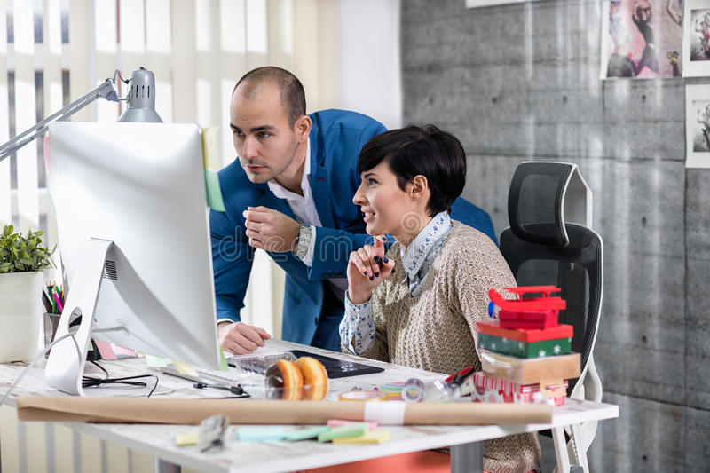 Two young designers working on pc stock photo