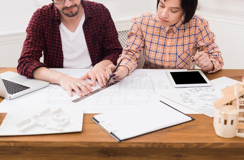 Two young designers working on project together. stock photo