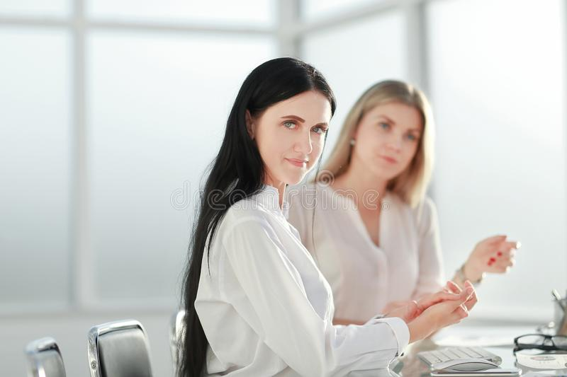 Two young employees in the workplace in the office. stock image