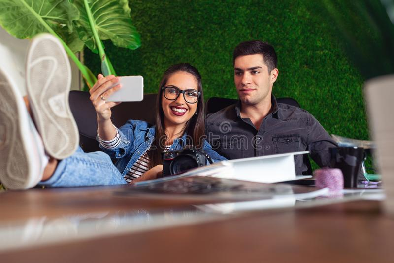 Two young engineers taking a selfie in the office stock photo