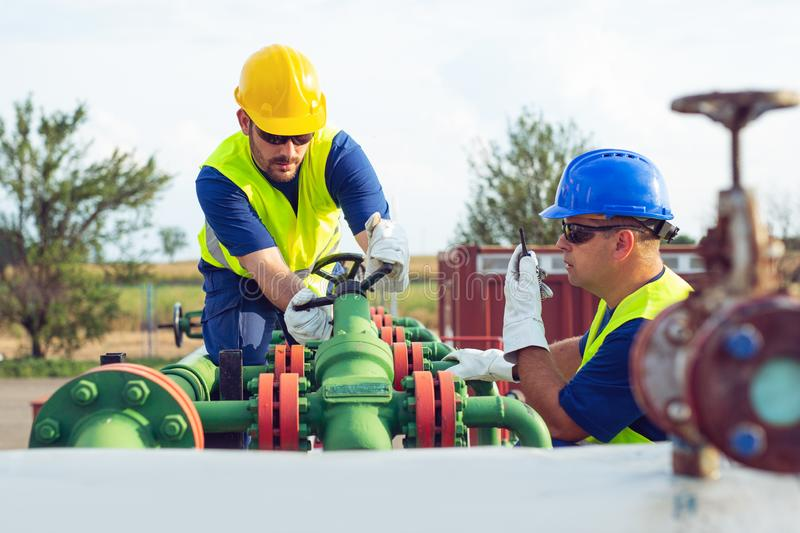Two engineers working inside oil and gas refinery royalty free stock photography