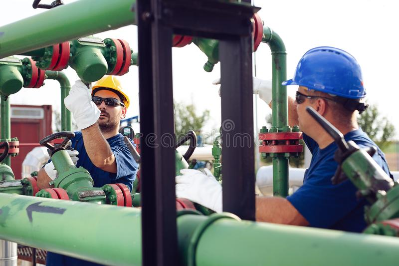 Two engineers working inside oil and gas refinery stock image