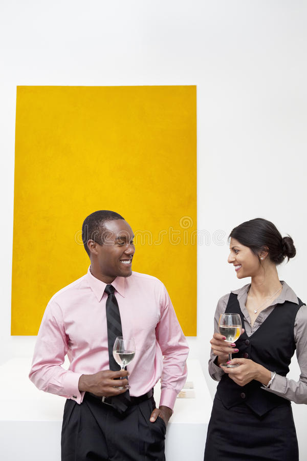Two young executives in front of yellow painting royalty free stock photos