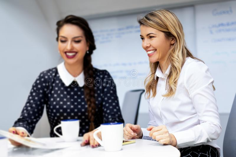 Two female colleagues in office stock photos