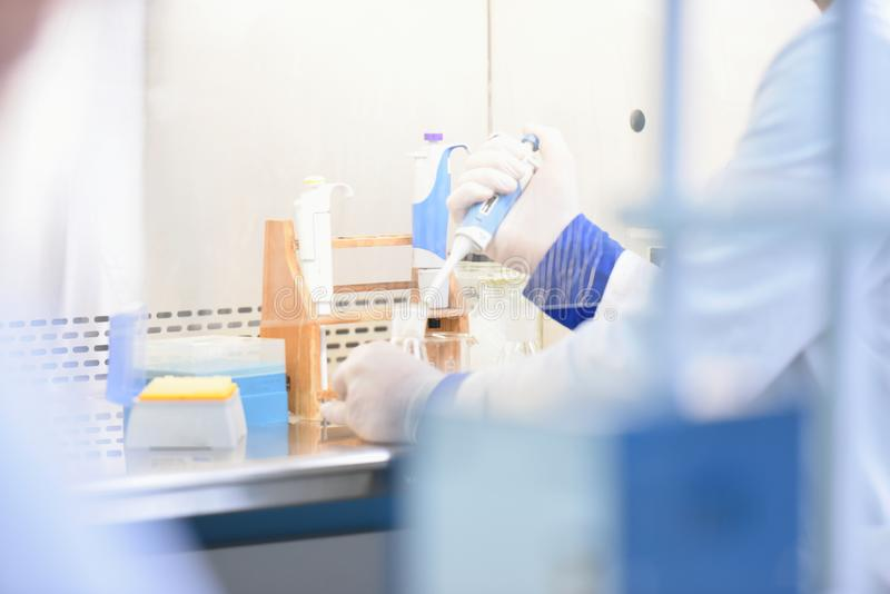 Two Young Female Laboratory scientist working at lab with test tubes, test or research in clinical laboratory.Science, chemistry, stock photography
