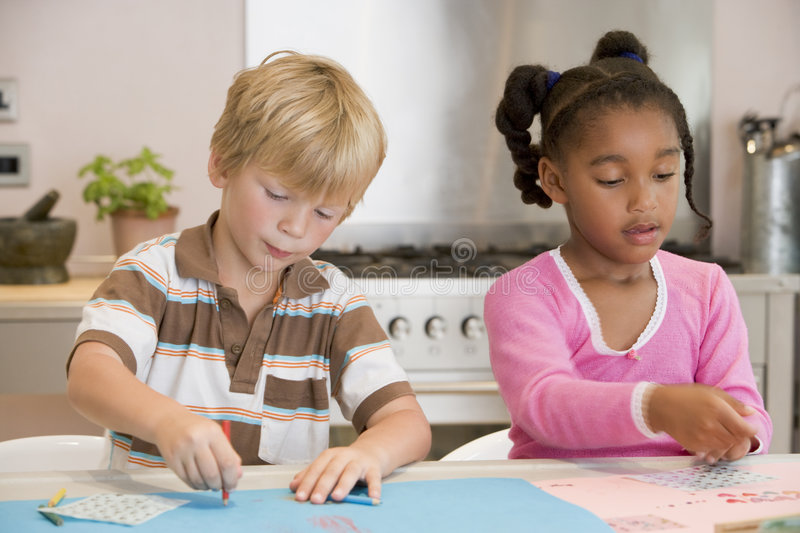 Two Young Friends Drawing Pictures stock photo