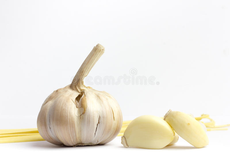 Two young garlic heads and cloves isolated on white background royalty free stock photos