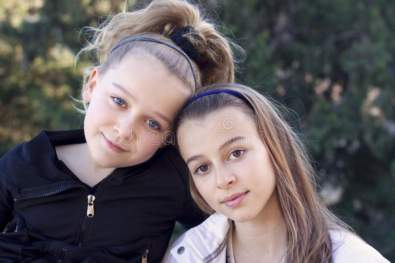 Two young girls best friends stock images