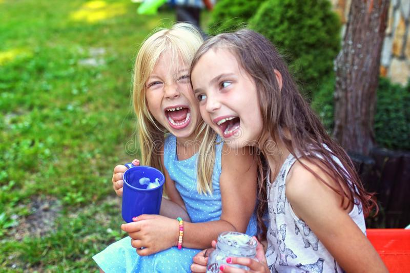 Two young girls have fun outside royalty free stock photos