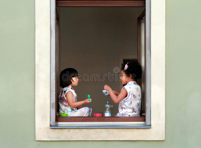 Two young girls having food and conversation at street food festival Dresden 27.07.2017 royalty free stock photo
