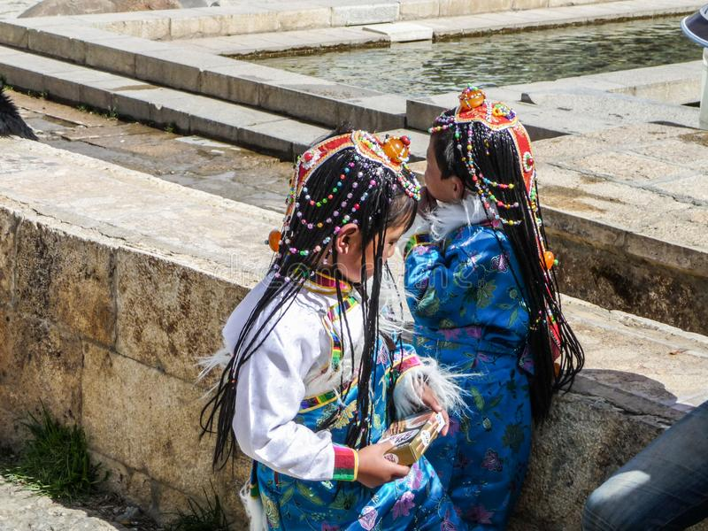 Two young girls of the Naxi minority in Zhongdian old town stock photography