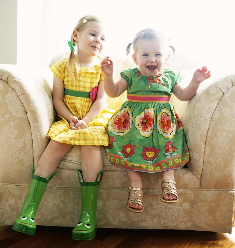 Free Two Young Girls On Chair Royalty Free Stock Photo - 13471215