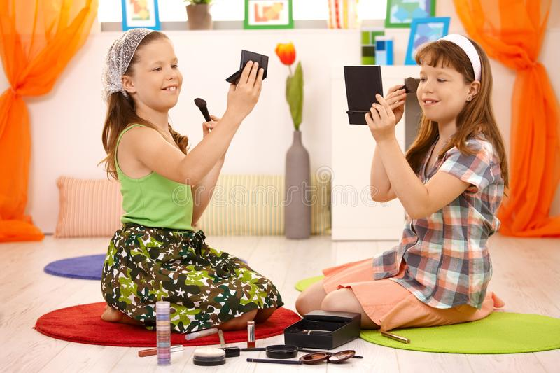 Two Young Girls Playing With Makeup Stock Photo