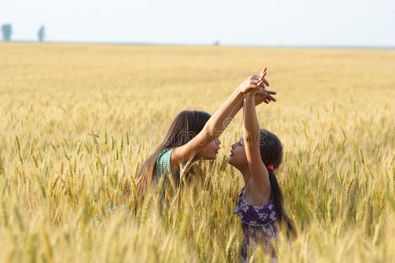Two Young Girls Playing Outdoor Stock Photos