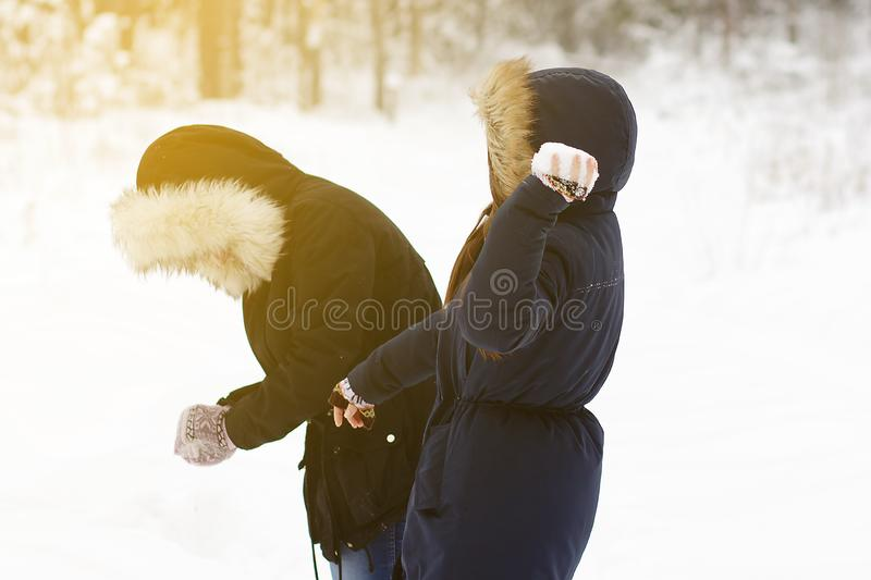 Two young girls are playing snowballs royalty free stock photography