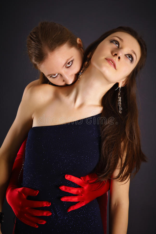 Two young girls portrayed vampire and sacrifice royalty free stock photo