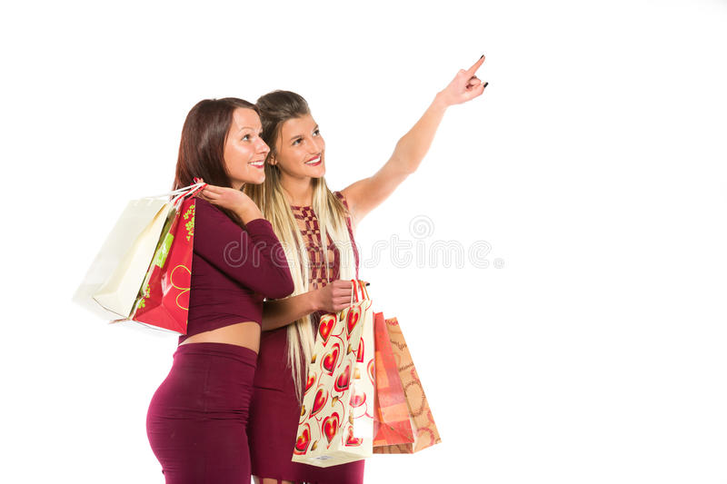 Two young girls with shopping bags royalty free stock photo